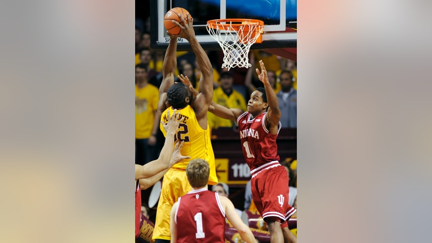 Indiana's Kevin Ferrell (11) pressures Minnesota's Trevor Mbakwe, left, during the first half of an NCAA college basketball game, Tuesday, Feb. 26, 2013, in Minneapolis. (AP Photo/Tom Olmscheid)