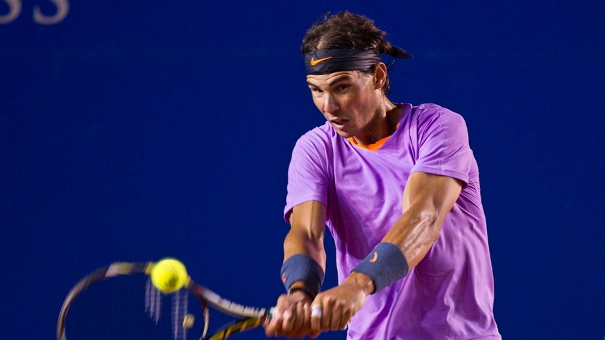 Spain's Rafael Nadal returns the ball to Argentina´s Diego Scwartzman during the Mexican Open Tennis in Acapulco, Mexico, Tuesday, Feb.  26, 2013. (AP Photo/Christian Palma)