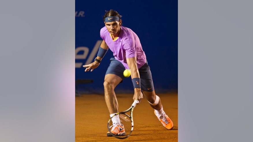 Spain's Rafael Nadal returns the ball to Argentina´s Diego Scwartzman during the Mexican Open Tennis in the Pacific resort in Acapulco, Tuesday, Feb.  26, 2013. (AP Photo/Christian Palma)