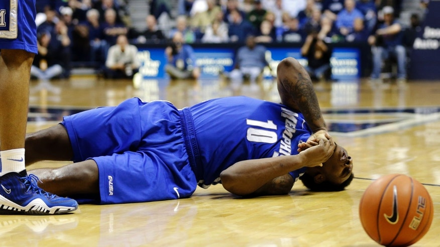 Memphis forward Tarik Black lies on the court after a collision in the second half of an NCAA college basketball game against Xavier, Tuesday, Feb. 26, 2013, in Cincinnati. Xavier won 64-62. (AP Photo/Al Behrman)