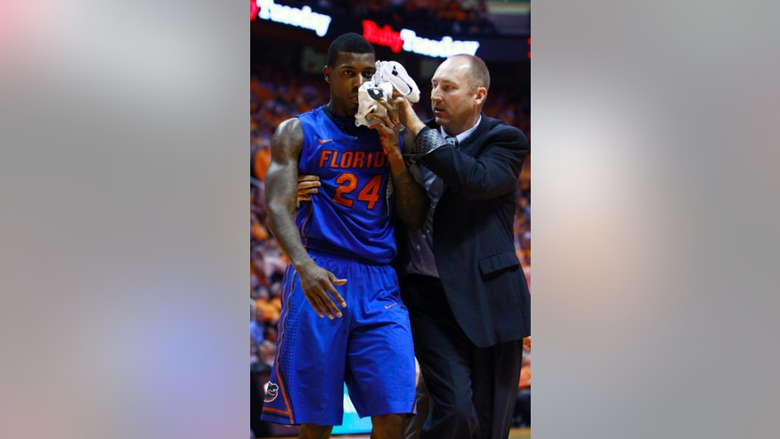 Florida's Casey Prather (24) is taken from the court after being injured in the second half of an NCAA college basketball game against Tennessee on Tuesday, Feb. 26, 2013, in Knoxville, Tenn. Tennessee won 64-58. (AP Photo/Wade Payne)