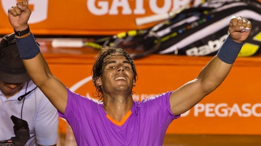 Spain´s Rafael Nadal rcelebrates after beating Spain´s Nicolas Almagro  in their semifinal game at the Mexican Open in Acapulco, Mexico,  early Saturday March 2,  2013. Nadal beat Almagro in straight sets to progress to the final of the Mexican Open.(AP Photo/Christian Palma)