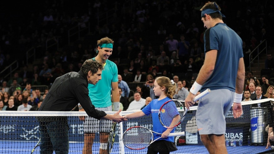 Actor Ben Stiller shakes hands with Rebecca Suarez, 9, of Huntington, N.Y. as Rafael Nadal, left, of Spain, and Juan Martin del Potro, right, of Argentina, look on during the BNP Paribas Showdown exhibition tennis match Monday, March 4, 2013, at Madison Square Garden in New York.  Stiller and Suarez were invited to play during the match. (AP Photo/Bill Kostroun)