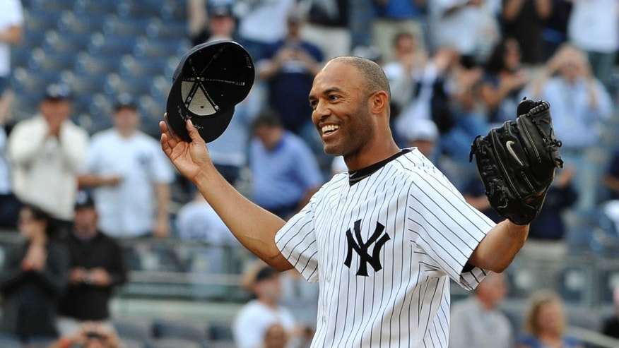 In this Sept, 19, 2011 file photo, New York Yankees closer Mariano Rivera acknowledges the cheers of the crowd after recording his 602nd career save, after the Yankees beat the Minnesota Twins 6-4 in a baseball game at Yankee Stadium in New York.
