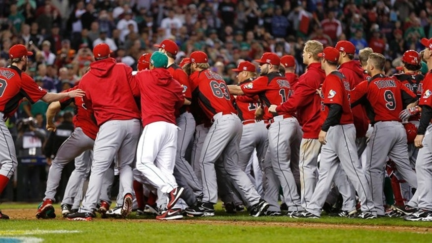 March 9, 2013: Players from Canada and Mexico fight during the ninth inning of a World Baseball Classic game, in Phoenix.