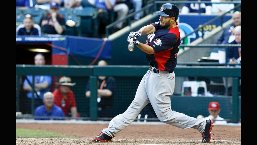 United States' Eric Hosmer connects for a double against Canada in the ninth nning during a World Baseball Classic baseball game on Sunday, March 10, 2013, in Phoenix.  The United States defeated Canada 9-4. (AP Photo/Ross D. Franklin)