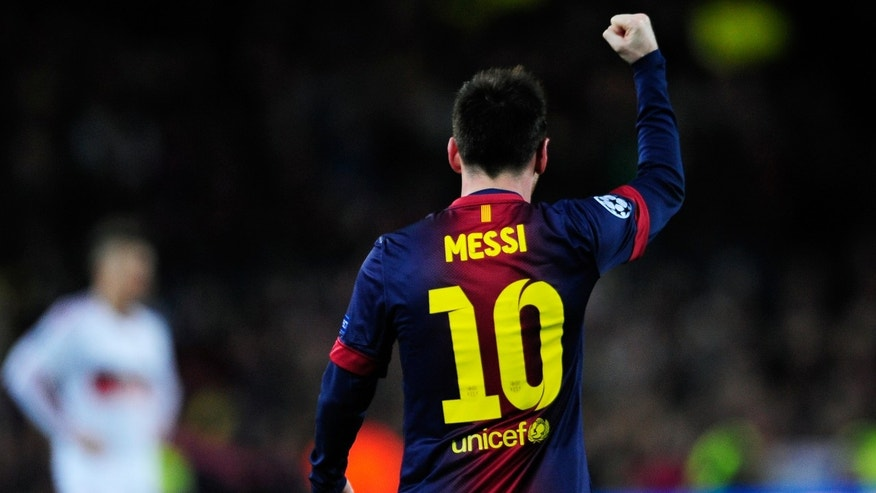 Barcelona's forward Lionel Messi, from Argentina, gestures during the Champions League round of 16 second leg soccer match between FC Barcelona and AC Milan at Camp Nou stadium, in Barcelona, Spain, Tuesday, March 12, 2013. (AP Photo/Manu Fernandez)