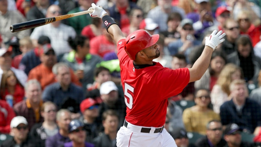 Los Angeles Angels' Albert Pujols watches his home run against the Colorado Rockies during the thrid inning of a spring training baseball game in Tempe, Ariz. Saturday, March 9, 2013. (AP Photo/Chris Carlson)
