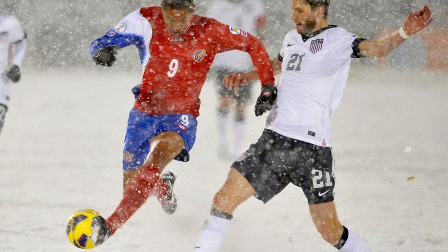 Costa Rica forward Alvaro Saborio (9) and United States defender Clarence Goodson (21) go after the ball during the second half of a World Cup qualifier soccer match in Commerce City, Colo., Friday, March 22, 2013. The United States beat Costa Rica 1-0. (AP Photo/Jack Dempsey)