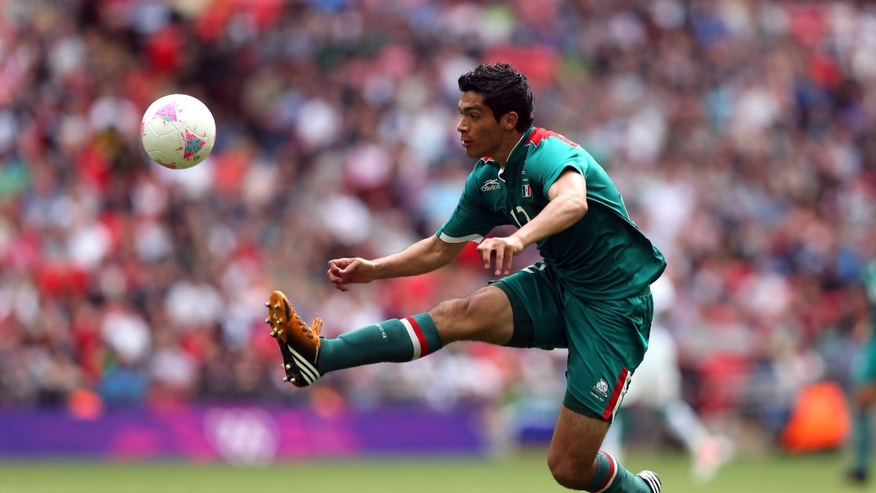 LONDON, ENGLAND - AUGUST 04:  Raul Jimenez of Mexico leaps for the ball during the Men's Football Quarter Final match between  Mexico and Senegal, on Day 8 of the London 2012 Olympic Games at Wembley Stadium on August 4, 2012 in London, England.  (Photo by Ezra Shaw/Getty Images)