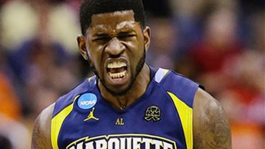 Mar. 28, 2013: Marquette forward Jamil Wilson (0) reacts to a call during the first half of an East Regional semifinal in the NCAA college basketball tournament against Miami.