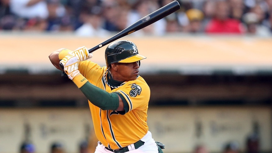 OAKLAND, CA - JULY 02:  Yoenis Cespedes #52 of the Oakland Athletics bats against the Boston Red Sox at O.co Coliseum on July 2, 2012 in Oakland, California.  (Photo by Ezra Shaw/Getty Images) *** Local Caption *** Yoenis Cespedes