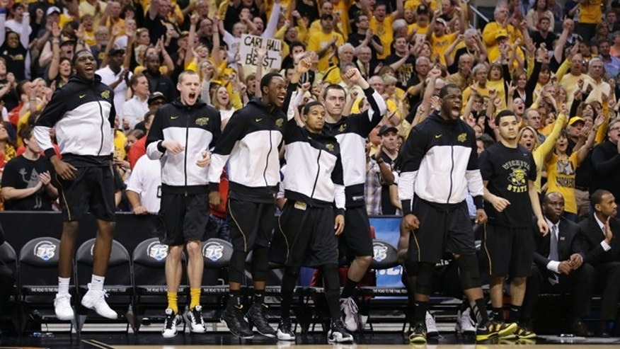 March 30, 2013: Wichita State players react to a field goal scored against Ohio State during the second half of the West Regional final in the NCAA men&#39&#x3b;s college basketball tournament in Los Angeles.