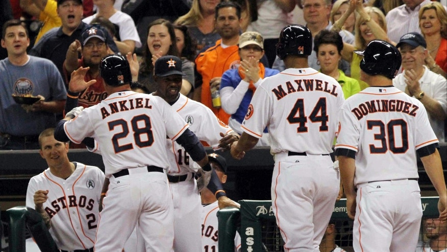 Houston Astros' Rick Ankiel (28) hugs manager Bo Porter after hitting a three-run home run against the Texas Rangers in the sixth inning of a season-opening baseball game at Minute Maid Park, Sunday, March 31, 2013, in Houston. Houston won 8-2. (AP Photo/Conroe Courier, Jason Fochtman)
