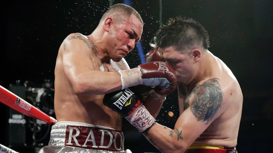 Mike Alvarado, left, exchanges punches with Brandon Rios during a WBO super lightweight title fight, Saturday, March 30, 2013, in Las Vegas. Alvarado won my unanimous decision. (AP Photo/Julie Jacobson)