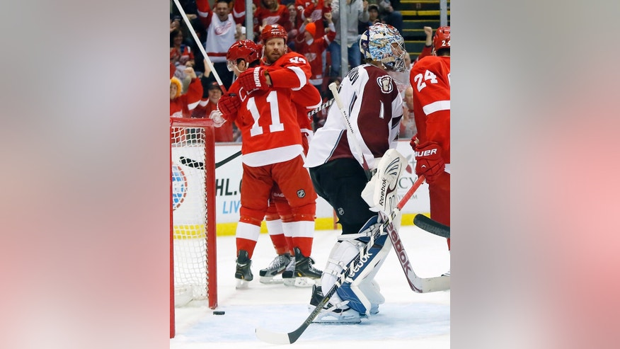 Detroit Red Wings right wing Daniel Cleary (11) gets a hug from left wing Johan Franzen, of Sweden, after scoring on Colorado Avalanche goalie Semyon Varlamov (1), of Russia, in the second period of an NHL hockey game Monday, April 1, 2013, in Detroit. (AP Photo/Duane Burleson)