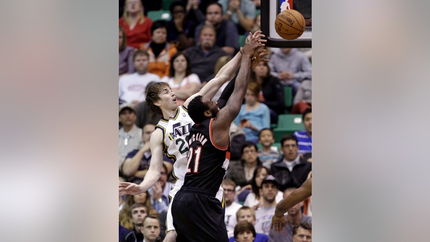 Utah Jazz's Gordon Hayward (20) and Portland Trail Blazers' J.J. Hickson (21) go after a rebound in the fourth quarter during an NBA basketball game Monday, April 1, 2013, in Salt Lake City. The Jazz defeated the Trail Blazers 112-102.  (AP Photo/Rick Bowmer)
