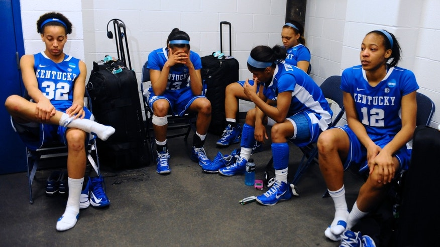 Kentucky's Kastine Evans, from left, Bria Goss, DeNesha Stallworth, Janee Thompson and Jelleah Sidney react in the locker room after losing a regional final game against Connecticut in the women's NCAA college basketball tournament in Bridgeport, Conn., Monday, April 1, 2013. Connecticut won 83-53. (AP Photo/Jessica Hill)