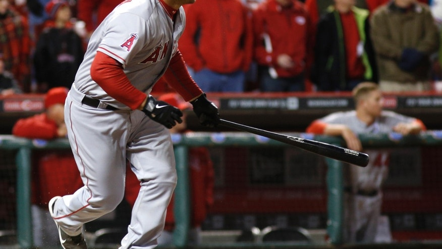 Los Angeles Angels' Chris Iannetta drives in two runs with a single off Cincinnati Reds relief pitcher J.J. Hoover in the 13th inning of an opening day baseball game, Monday, April 1, 2013, in Cincinnati. Los Angeles won 3-1. (AP Photo/David Kohl)