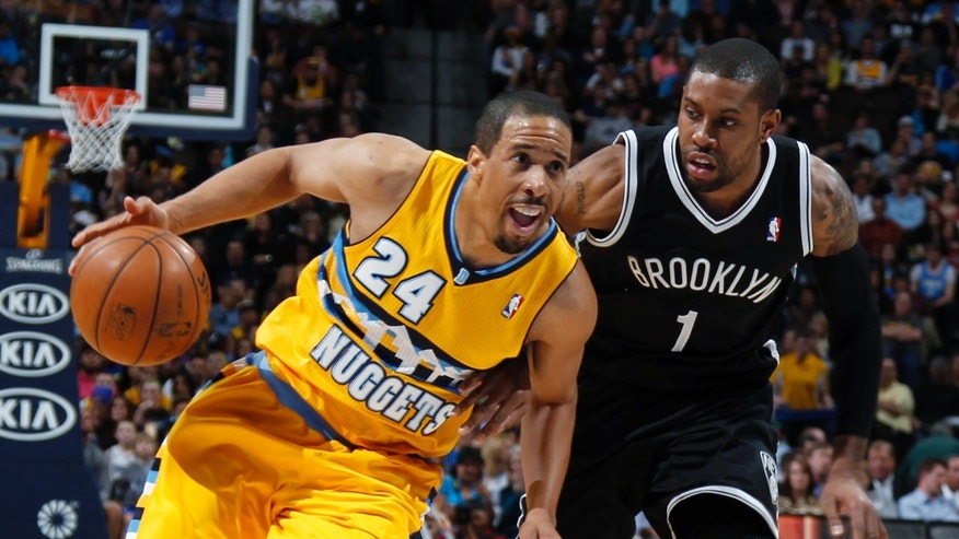 Denver Nuggets guard Andre Miller, left, works ball inside as Brooklyn Nets guard C.J. Watson defends during the third quarter of the Nuggets' 109-87 victory in an NBA basketball game in Denver on Friday, March 29, 2013. (AP Photo/David Zalubowski)