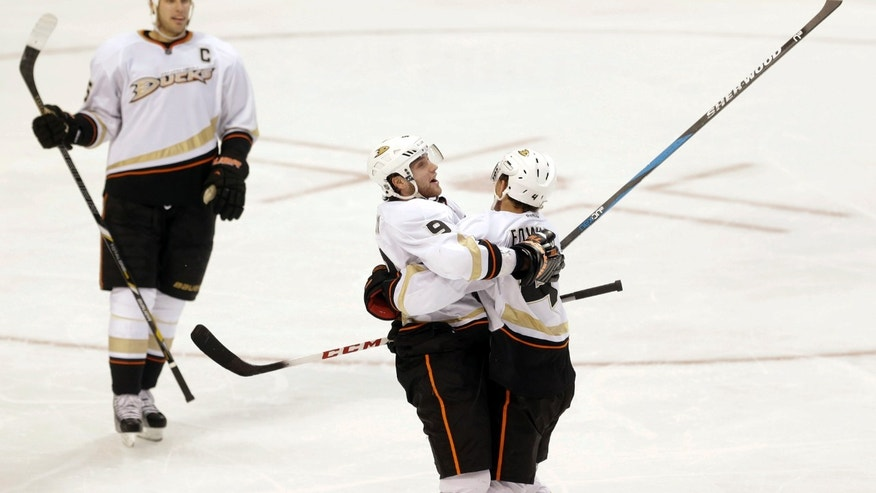 Anaheim Ducks forward Bobby Ryan, center, celebrates a goal with Cam Fowler, right, and Ryan Getzlaf, left, during the second period of an NHL hockey game against the Dallas Stars in Dallas on Monday April 1, 2013.  (AP Photo/Mike Fuentes)