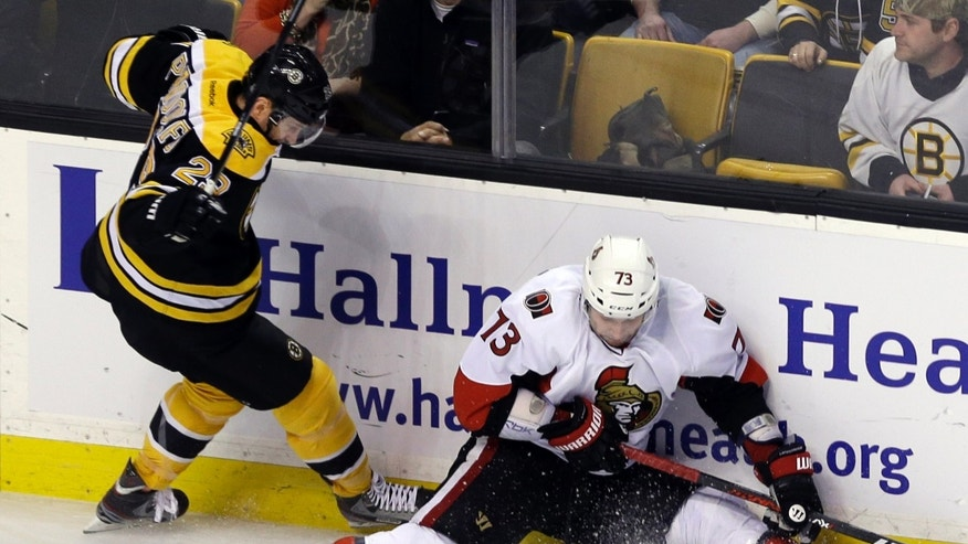 Ottawa Senators left wing Guillaume Latendresse (73) tries to control the puck against Boston Bruins left wing Jay Pandolfo (29) in the first period of an NHL hockey game in Boston, Tuesday, April 2, 2013. (AP Photo/Elise Amendola)