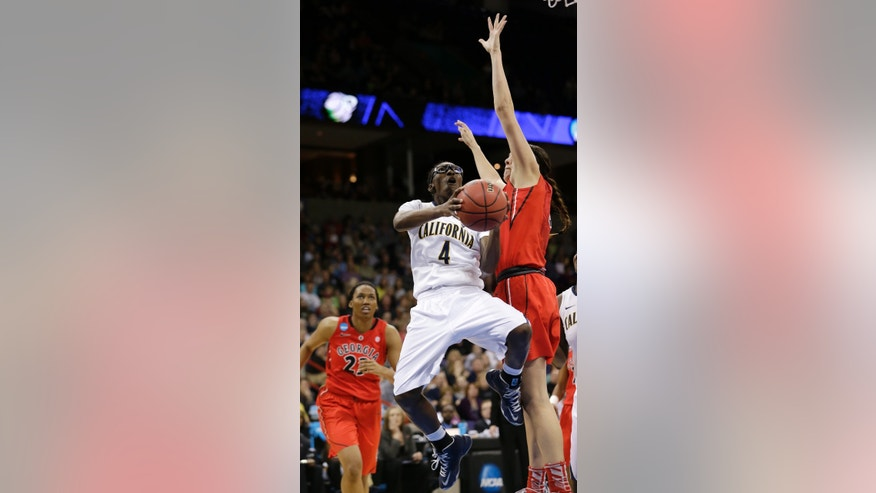 California's Eliza Pierre (4) drives against Georgia's Anne Marie Armstrong during the second half in a regional final in the NCAA women's college basketball tournament, Monday, April 1, 2013, in Spokane, Wash. (AP Photo/Elaine Thompson)