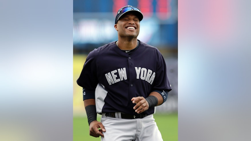 FILE - In this March 22, 2013, file photo, New York Yankees' Robinson Cano laughs before a spring training baseball game against the Minnesota Twins in Fort Myers, Fla. Now that Alex Rodriguez, Mark Teixeira, Curtis Granderson and Derek Jeter are out of the lineup, Cano is the man on the Yankees.  (AP Photo/Elise Amendola, File)