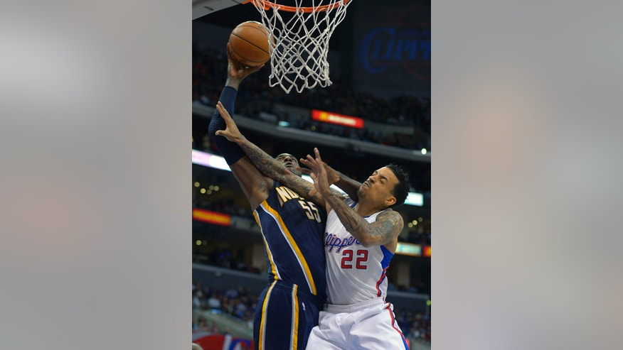 Indiana Pacers center Roy Hibbert, left, shoots Los Angeles Clippers forward Matt Barnes defends during the first half of their NBA basketball game, Monday, April 1, 2013, in Los Angeles. (AP Photo/Mark J. Terrill)