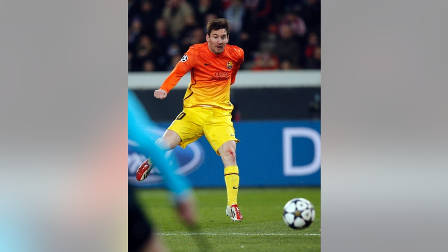 Barcelona's Lionel Messi scores the opening goal during his Champions League quarterfinal soccer match against Paris Saint Germain in Paris,Tuesday, April 2, 2013. (AP Photo/Christophe Ena)