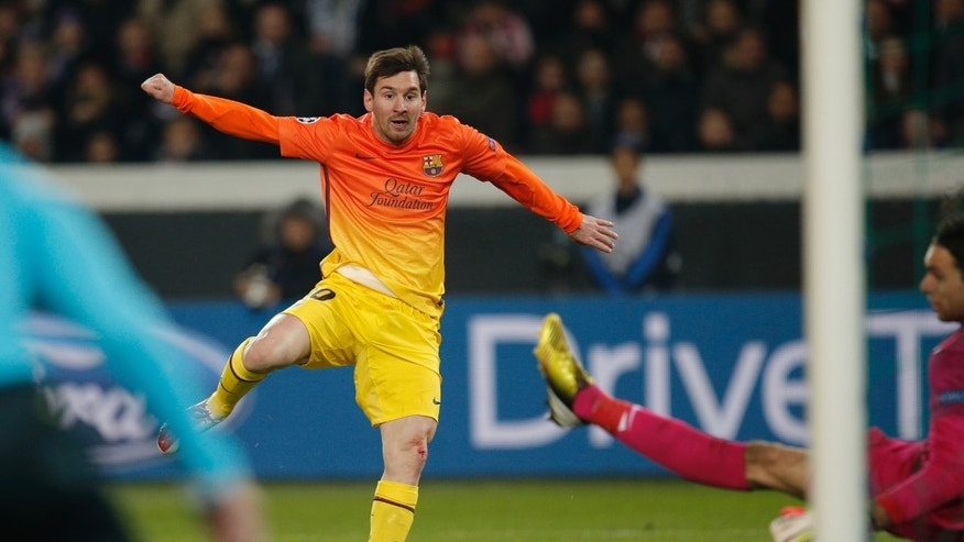 Barcelona's Lionel Messi scores the opening goal while Paris Saint Germain's goalkeeper Salvatore Sirigu of Italy looks on during their Champions League quarterfinal soccer match in Paris,Tuesday, April 2, 2013. (AP Photo/Christophe Ena)