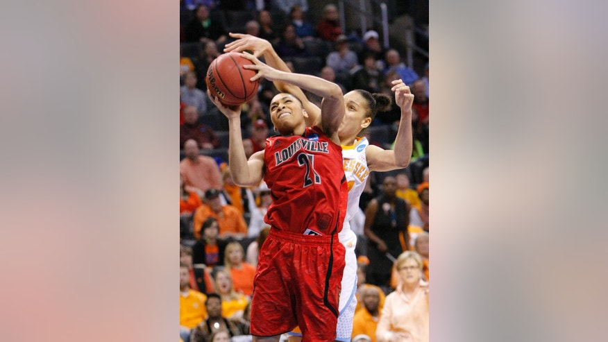 Louisville's Bria Smith, front, is fouled by Tennessee's Cierra Burdick, back, during the first half of the Oklahoma City regional final in the NCAA women's college basketball tournament in Oklahoma City, Tuesday, April 2, 2013. (AP Photo/Alonzo Adams)