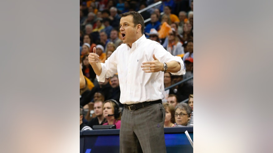 Louisville coach Jeff Walz shouts during the first half against Tennessee in the regional final of the NCAA women's college basketball tournament in Oklahoma City, Tuesday, April 2, 2013.  (AP Photo/Sue Ogrocki)