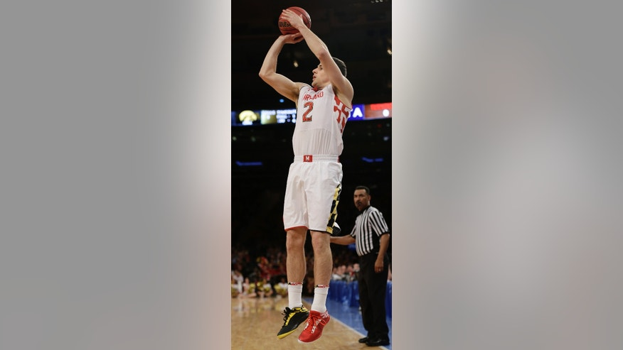 Maryland's Logan Aronhalt (2) shoots a during the first half of an NIT semifinal basketball game against Iowa Tuesday, April 2, 2013, in New York. (AP Photo/Frank Franklin)