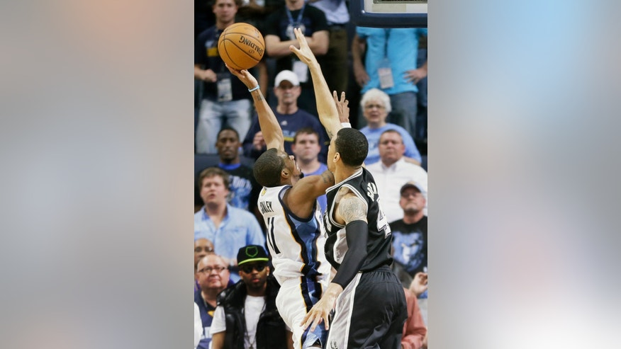 Memphis Grizzlies' Mike Conley (11) makes the game-winning shot over San Antonio Spurs' Danny Green, right, with less than one second left in the second half of an NBA basketball game in Memphis, Tenn., Monday, April 1, 2013. The Grizzlies defeated the Spurs 92-90. (AP Photo/Danny Johnston)