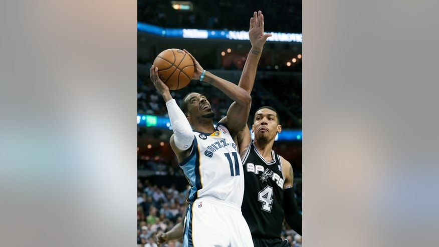 Memphis Grizzlies' Mike Conley (11) shoots in front of San Antonio Spurs' Danny Green (4) during the first half of an NBA basketball game in Memphis, Tenn., Monday, April 1, 2013. Conley scored 23 points in the Grizzlies 92-90 victory over the Spurs. (AP Photo/Danny Johnston)