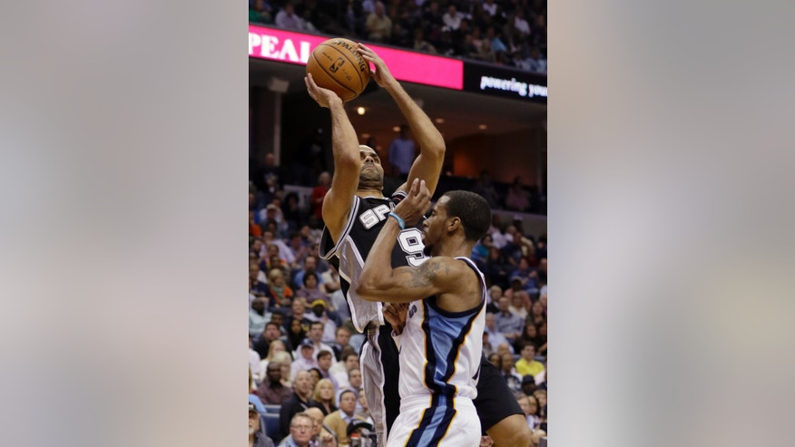 San Antonio Spurs' Tony Parker (9), of France, shoots over Memphis Grizzlies' Mike Conley during the second half of an NBA basketball game in Memphis, Tenn., Monday, April 1, 2013. Parker scored 25 points in the Spurs' 92-90 loss to the Grizzlies. (AP Photo/Danny Johnston)