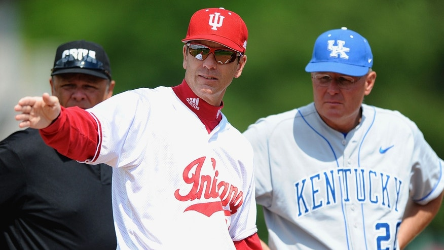 In this photo taken May 11, 2010, and provided by the University of Indiana, Indiana coach Tracy Smith talks with Kentucky coach Gary Henderson, right, during a college baseball game in Bloomington, Ind. Coach Smith has upgraded the talent in his eight seasons at Indiana and might have his best team yet. (AP Photo/University of Indiana, Mike Dickbernd)