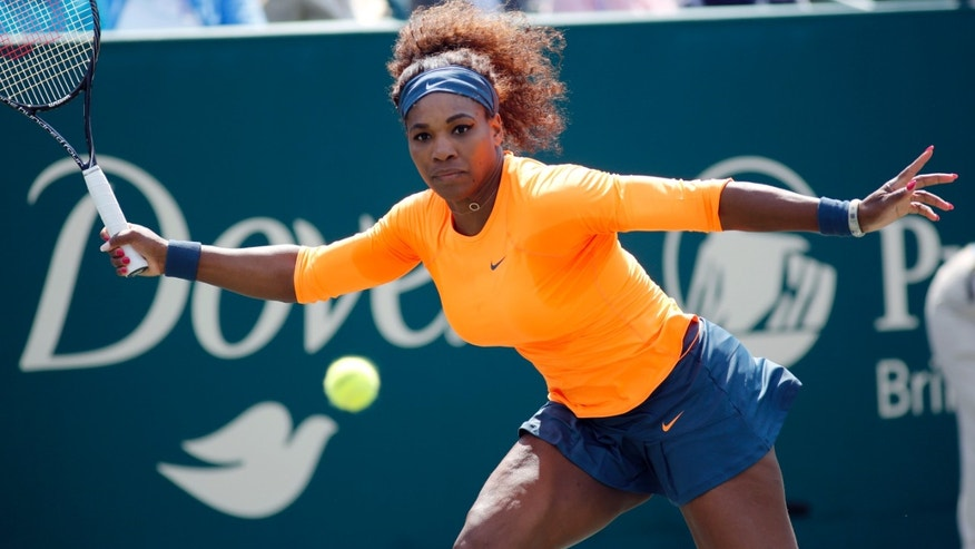 Serena Williams, of the United States, returns to Camila Giorgi, of Italy, at the Family Circle Cup tennis tournament in Charleston, S.C., Tuesday, April 2, 2013.  Williams won 6-2, 6-3. (AP Photo/Mic Smith)