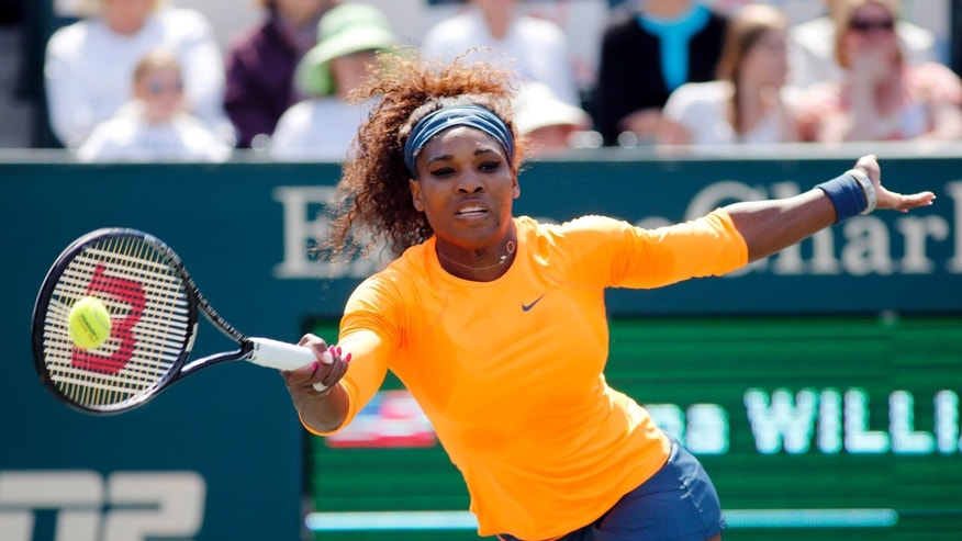 Serena Williams returns to Camila Giorgi, of Italy, during their match at the Family Circle Cup tennis tournament in Charleston, S.C., Tuesday, April 2, 2013. Williams won 6-2, 6-3. (AP Photo/Mic Smith)