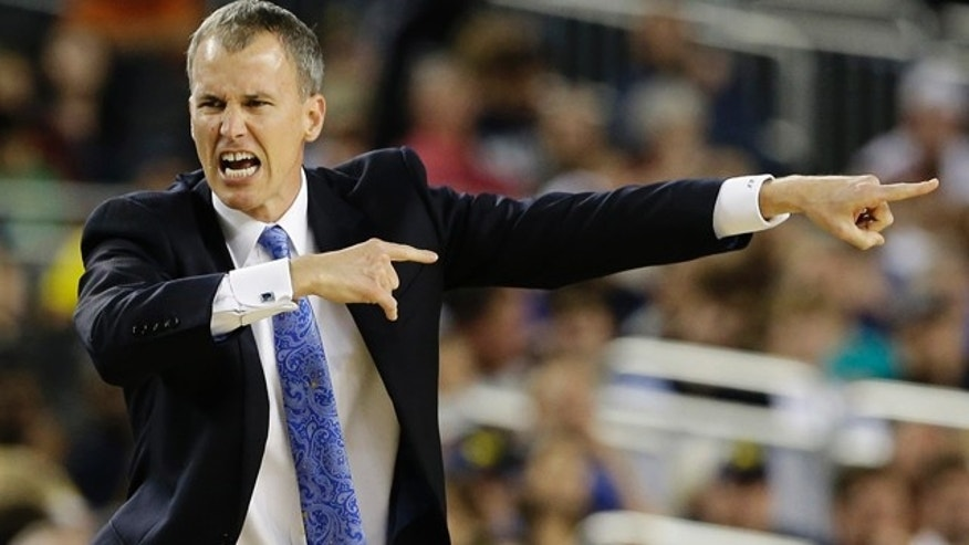 Mar. 30, 2013: Florida Gulf Coast head coach Andy Enfield reacts to action against Florida during the second half of a regional semifinal game in the NCAA college basketball tournament.