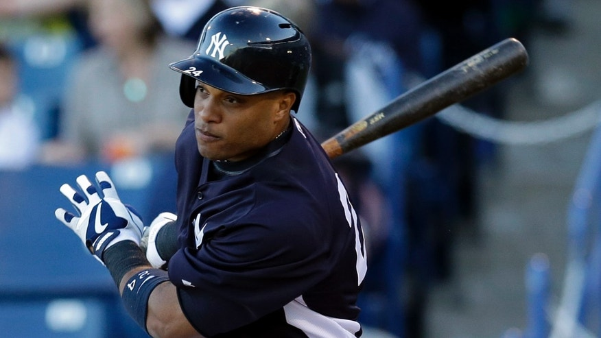 FILE - In this March 21, 2013, file photo, New York Yankees Robinson Cano bats during a spring training baseball game in Tampa, Fla. Now that Alex Rodriguez, Mark Teixeira, Curtis Granderson and Derek Jeter are out of the lineup, Cano is the man on the Yankees.  (AP Photo/Kathy Willens, File)