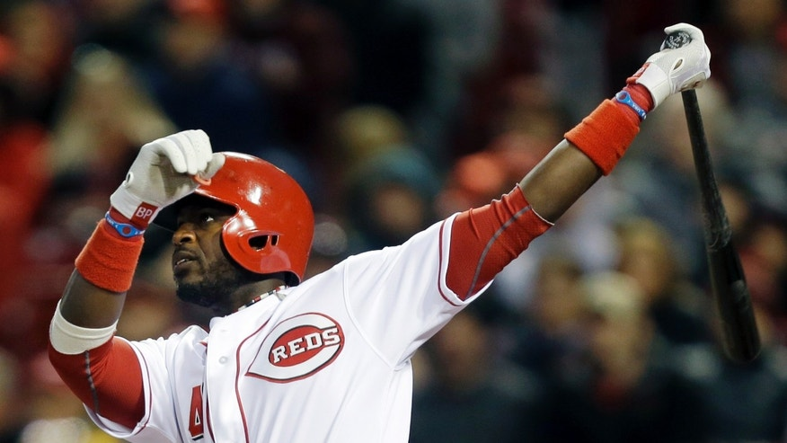 Cincinnati Reds' Brandon Phillips hits a three-run home run off Los Angeles Angels starting pitcher C.J. Wilson in the fourth inning of a baseball game, Wednesday, April 3, 2013, in Cincinnati. (AP Photo/Al Behrman)