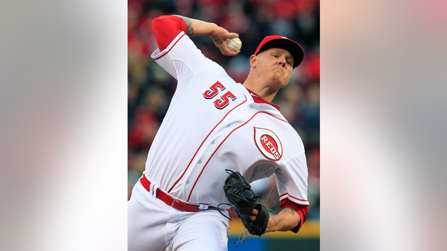 Cincinnati Reds starting pitcher Mat Latos throws against the Los Angeles Angels in the first inning of a baseball game, Wednesday, April 3, 2013, in Cincinnati. (AP Photo/Al Behrman)