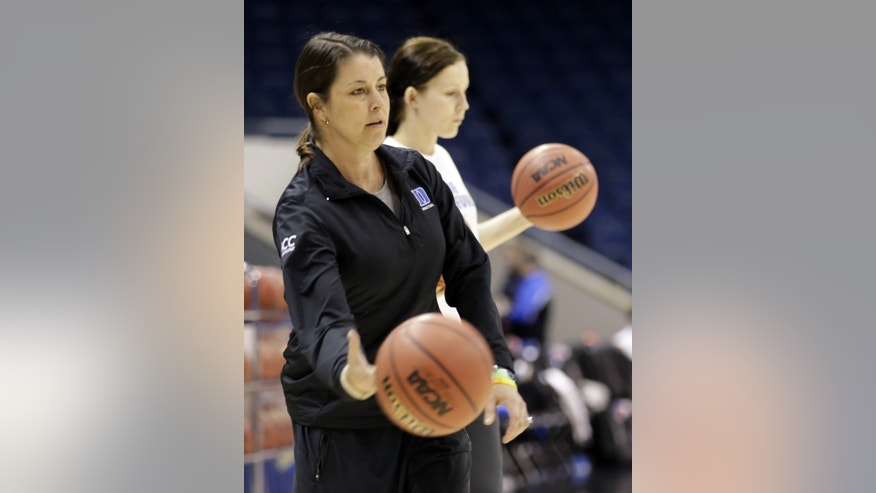 Duke head coach Joanne McCallie tosses a basketball during practice for an NCAA women's regional basketball game in Norfolk, Va., Saturday, March 30, 2013. Duke is scheduled to play sixth-seeded Nebraska on Sunday in the Norfolk Regional semifinals. (AP Photo/Steve Helber)