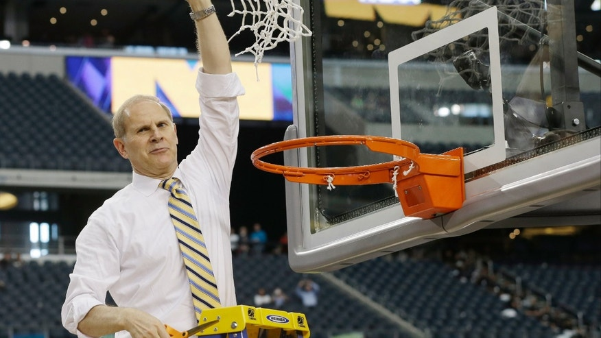 Michigan head coach John Beilein reacts after cutting down the net after a regional final game against Florida in the NCAA college basketball tournament, Sunday, March 31, 2013, in Arlington, Texas. Michigan won 79-59 to advance to the Final Four. (AP Photo/David J. Phillip)