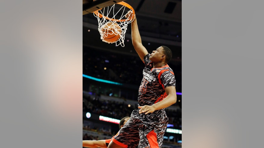 McDonald's West All-American's Jarell Martin dunks during the first half of the McDonald's All-American boys basketball game in Chicago, Wednesday, April 3, 2013. (AP Photo/Nam Y. Huh)