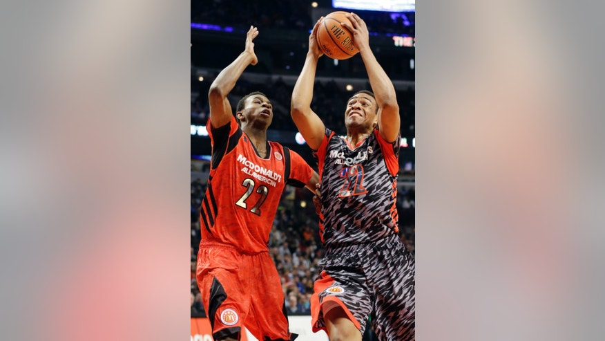 McDonald's West All-American's Jabari Parker, right, drives to the basket as McDonald's East All-American's Andrew Wiggins defends during the first half of the McDonald's All-American boys basketball game in Chicago, Wednesday, April 3, 2013. (AP Photo/Nam Y. Huh)