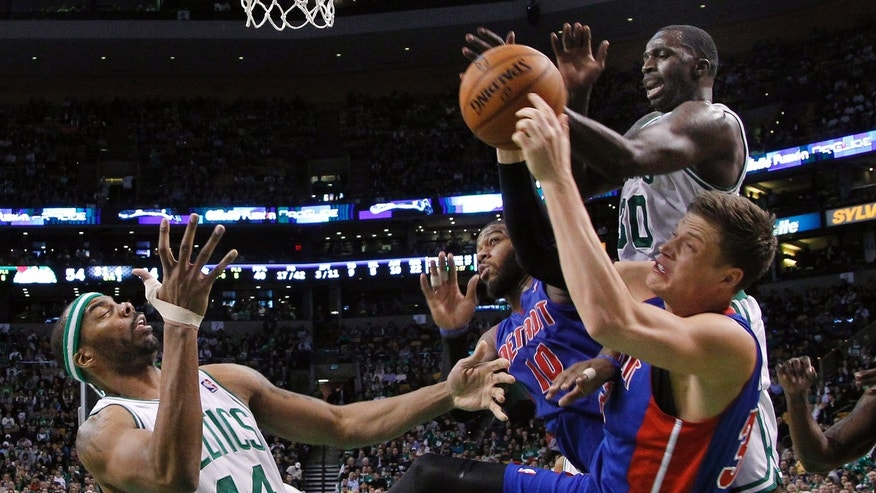 Detroit Pistons forward Jonas Jerebko, foreground, and center Greg Monroe (10) grapple for a rebound against Boston Celtics forwards Chris Wilcox (44) and Brandon Bass (30) in the second quarter of an NBA basketball game, Wednesday, April 3, 2013, in Boston. (AP Photo/Elise Amendola)