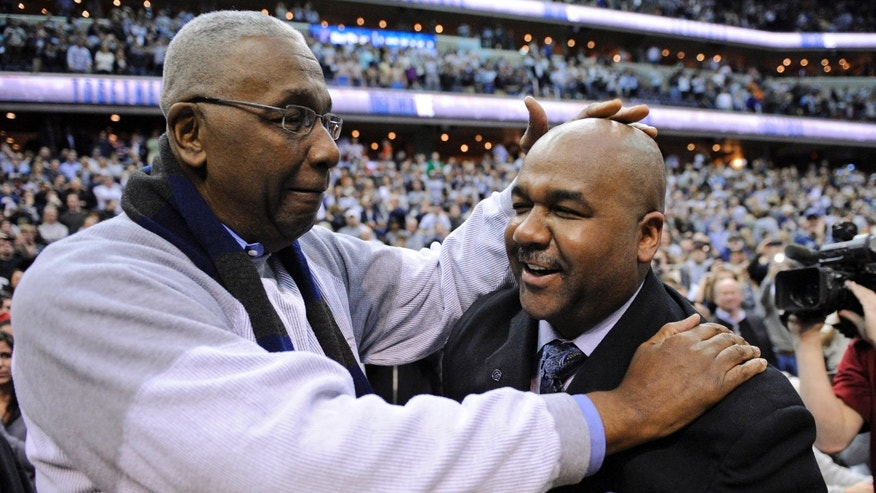 FILE - In this March 9, 2013, file photo, former Georgetown coach John Thompson Jr., left, congratulates his son Georgetown head coach John Thompson III, right, after the Hoya's 61-39 win over Syracuse in an NCAA college basketball game in Washington. Hall of Fame coaches John Thompson and Jim Calhoun say behavior like that caught on video of fired Rutgers coach Mike Rice isn't appropriate, and never was. (AP Photo/Nick Wass, File)